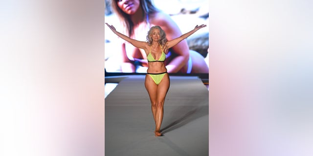 Kathy Jacobs walks the runway during the 2019 Sports Illustrated Swimsuit Runway Show During Miami Swim Week at W South Beach on July 14, 2019 in Miami Beach, Florida. (Photo by Frazer Harrison/Getty Images for Sports Illustrated)
