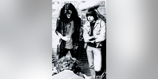 Joey (left) and Johnny Ramone posing for a portrait, circa 1988.