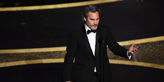 """We feel entitled to artificially inseminate a cow, and when she gives birth, we steal her baby,"" Phoenix said after winning the Oscar for best actor. (Photo by Kevin Winter/Getty Images)"