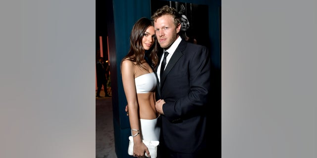 Emily Ratajkowski and Sebastian Bear-McClard attend the 2020 Vanity Fair Oscar Party hosted by Radhika Jones at Wallis Annenberg Center for the Performing Arts on February 09, 2020 in Beverly Hills, Calif.