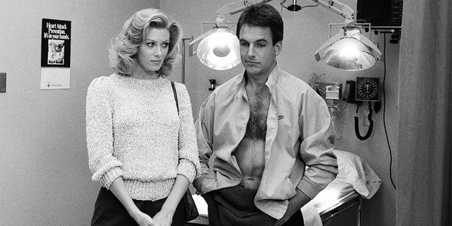 Pictured: (l-r) Nancy Stafford as Joan Halloran, Mark Harmon as Doctor Robert Caldwell in 'St. Elsewhere.'