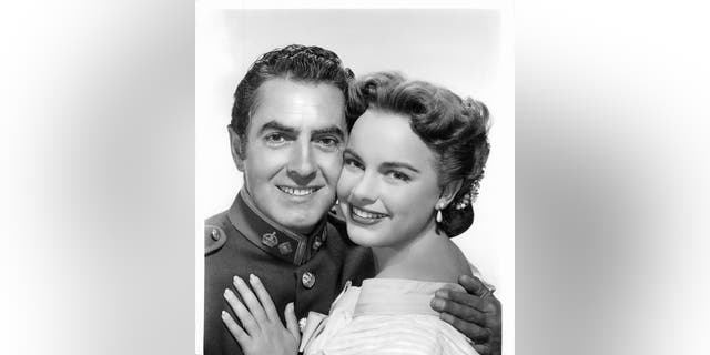 Tyrone Power and Terry Moore embracing in a scene from the film 'King Of The Khyber Rifles', 1953.