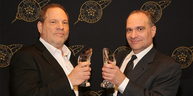 Harvey Weinstein (L) and Bob Weinstein pose with the Motion Picture Showmanship Award backstage at the 52nd Annual ICG Publicists Awards at The Beverly Hilton Hotel on February 20, 2015 in Beverly Hills, California.