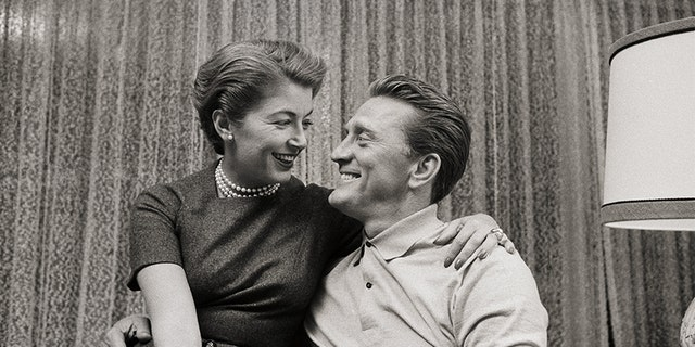 Actor Kirk Douglas and his wife Anne remained devoted to each other, pal claims.