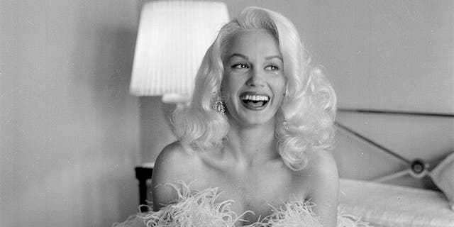 Actress Mamie Van Doren poses at home in Los Angeles, circa 1956.