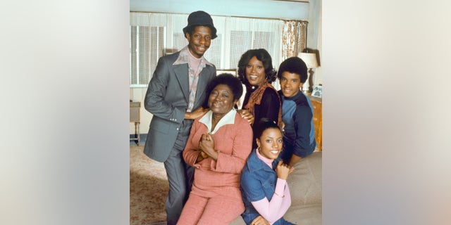 Portrait of the cast of the television show 'Good Times,' Los Angeles, California, August 5, 1977. Pictured are, front row, American actresses Esther Rolle (1920 - 1998) (left) and BernNadette Stanis; back row, from left, American actors Jimmie Walker, Ja'net DuBois, and Ralph Carter.