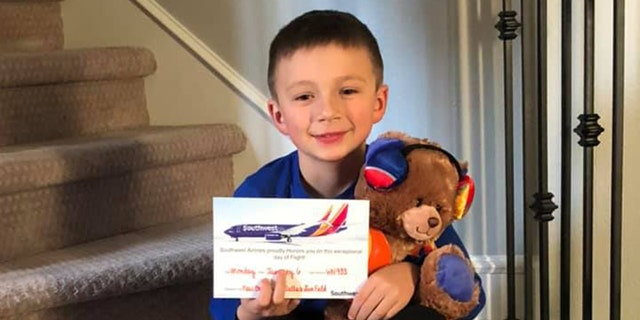 """Grayson, pictured here with his new friend """"Jack,"""" had earlier lost his favorite teddy bear on a Southwest Airlines flight."""
