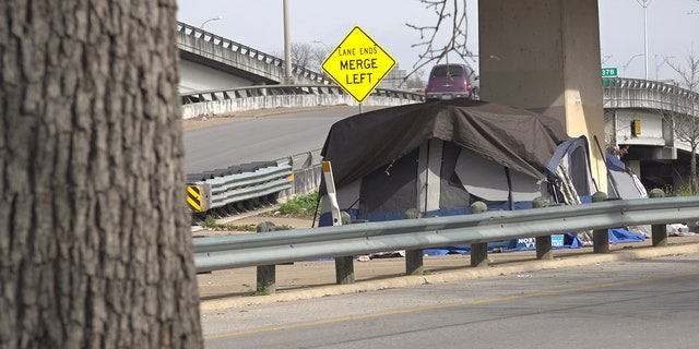 The City of Austin rolls back homeless camping ban, allowing camping under bridges.