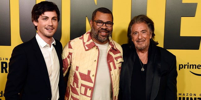 "Jordan Peele, center, executive producer of the Amazon Prime Video series ""Hunters,"" poses with cast members Logan Lerman, left, and Al Pacino at the premiere of the show at the Directors Guild of America, Wednesday, Feb. 19, 2020, in Los Angeles."