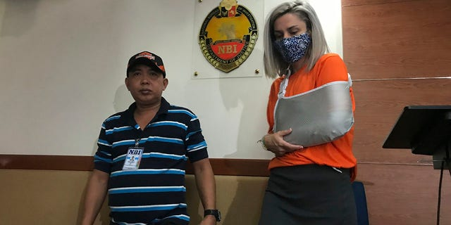 Talbot was presented to reporters in Manila for the second time on Wednesday after being accused of trying to smuggle a newborn baby out of the country. (AP Photo/Vicente Gonzales)