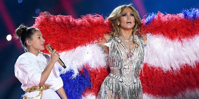 Emme Maribel Muñiz and Jennifer Lopez perform onstage during the Pepsi Super Bowl LIV Halftime Show at Hard Rock Stadium on February 02, 2020