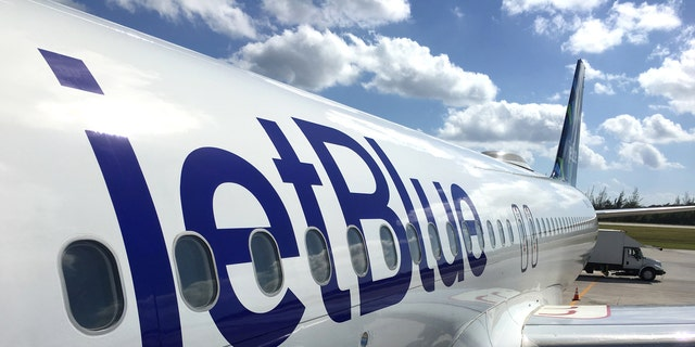 The airline said the man has since been banned from flying with JetBlue.