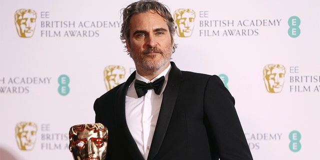 Joaquin Phoenix poses with his award for Best Actor for the film Joker, backstage at the Bafta Film Awards, in central London, Sunday, Feb. 2, 2020. (Photo by Joel C Ryan/Invision/AP)