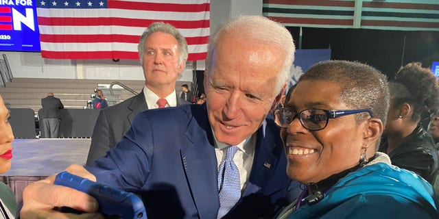 Former Vice President Joe Biden takes a selfie with a supporter at his South Carolina victory celebration, on Feb. 29, 2020 in Columbia, SC