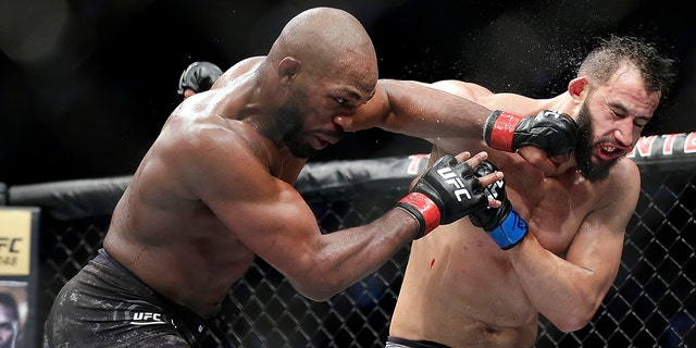 Jon Jones, left, connecting with a punch to the face of Dominick Reyes at UFC 247 in Houston. (AP Photo/Michael Wyke)