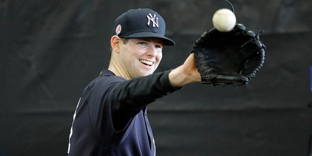 New York Yankees' Jordan Montgomery smiles during a spring training baseball workout Thursday, Feb. 13, 2020, in Tampa, Fla. (AP Photo/Frank Franklin II)