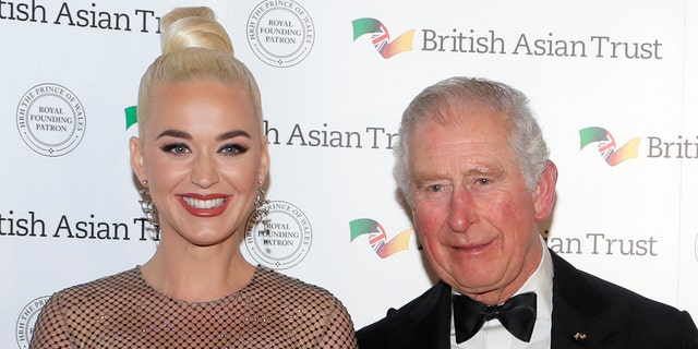 Prince Charles, Prince of Wales, Royal Founding Patron of the British Asian Trust poses with American musician Katy Perry as they arrive to attend a reception for supporters of the British Asian Trust on Feb. 4, 2020.