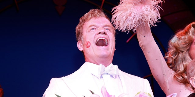 """Kelsey Grammer performs in the opening of """"La Cage Aux Folles"""" on Broadway in 2010 in New York City. (Photo by Charles Eshelman/Getty Images)"""