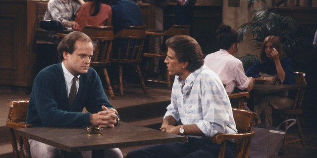 """Kelsey Grammer as Dr. Frasier Crane and Ted Danson as Sam Malone in """"Cheers."""" (Photo by: NBCU Photo Bank via Getty)"""