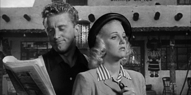Kirk Douglas and Jan Sterling in 'Ace in The Hole' (1951).