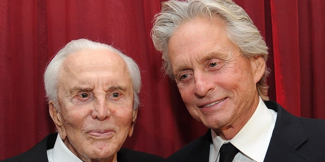 Kirk Douglas (L) and Michael Douglas in 2011. (Photo by Michael Buckner/Getty Images)