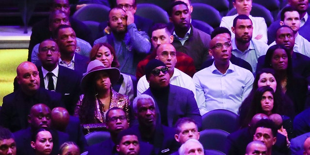 LL Cool J, middle, watches during a celebration of life for Kobe Bryant and his daughter Gianna Monday, Feb. 24, 2020, in Los Angeles. (AP Photo/Marcio Jose Sanchez)