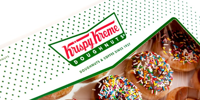 """""""Chula Vista, USA - May 11, 2011: Studio shot of an instantly recognizeable Krispy Kreme Doughnuts box filled with an assortment of delicous doughnuts."""""""