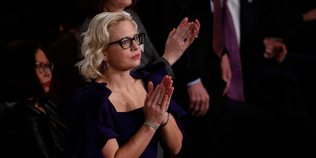 U.S. Sen. Kyrsten Sinema, D-Ariz., applauds during former President Trump's State of the Union address at the U.S. Capitol in Washington, Feb. 4, 2020. (Getty Images)
