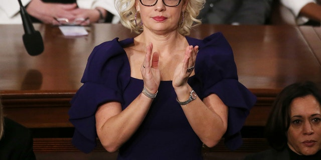 Sen. Krysten Sinema, D-Ariz., applauds during the State of the Union address in the chamber of the U.S. House of Representatives on Feb. 4, 2020 in Washington, D.C. (Mario Tama/Getty Images)