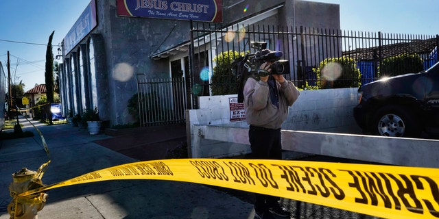 In this Wednesday, Jan. 29, 2020, file photo, crime scene tape is seen closing off an area around the grounds of the Kingdom of Jesus Christ Church in the Van Nuys section of Los Angeles. (AP Photo/Richard Vogel, File)