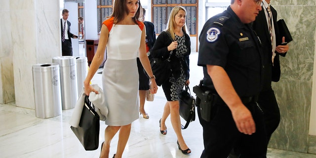 Former FBI lawyer Lisa Page, left, arrives for a closed doors interview with the House Judiciary and House Oversight committees, Monday, July 16, 2018, on Capitol Hill in Washington. (AP Photo/Jacquelyn Martin)