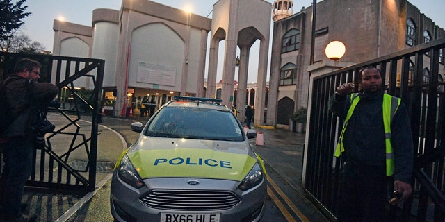 Police outside London Central Mosque in Regent's Park, where police have arrested a man on suspicion of attempted murder, in London, Thursday, Feb. 20, 2020. (Victoria Jones/PA via AP)