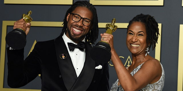 "Matthew A. Cherry, left, and Karen Rupert Toliver, winners of the award for best animated short film for ""Hair Love"", pose in the press room at the Oscars on Sunday, Feb. 9, 2020, at the Dolby Theatre in Los Angeles. (Photo by Jordan Strauss/Invision/AP)"