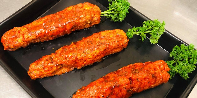 "Samways' meat-based ""carrots"" are made from seasoned minced pork, an orange-hued Italian seasoning glaze and parsley."