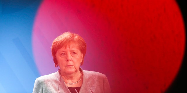 German Chancellor Angela Merkel listens to Hungary's Prime Minister Victor Orban during a joint statement prior to a meeting at the chancellery in Berlin, Germany, Monday. (AP Photo/Markus Schreiber)