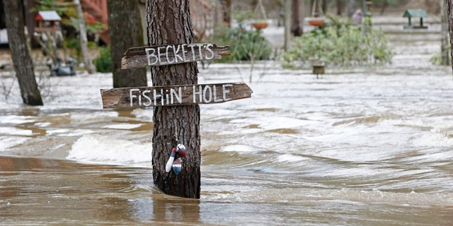 Water from the Pearl River floods Florence-Byram Road near Byram, Miss, Monday, Feb. 17, 2020.