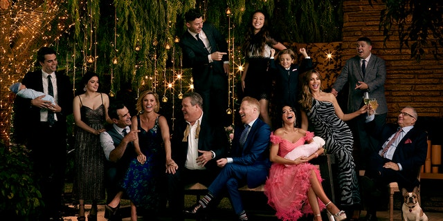 The 'Modern Family' cast poses for a group shot as the show is set to end in April after 11 seasons.