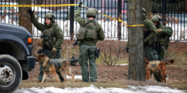 Police respond to reports of an active shooting at the Molson Coors Brewing Co. campus in Milwaukee. (AP Photo/Morry Gash)