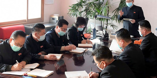 In this photo distributed on Feb. 12, by the North Korean government, North Korean Premier Kim Jae Ryon, right top, has a meeting at the emergency anti-epidemic headquarter in Pyongyang, North Korea. (Korean Central News Agency/Korea News Service via AP)
