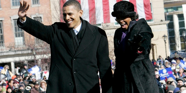 U.S. Senator Barack Obama (D-IL), with wife Michelle (R), waves after formally announcing his campaign for U.S. President in the 2008 election during a campaign rally in front of the Old State Capitol in Springfield, Illinois, February 10, 2007.