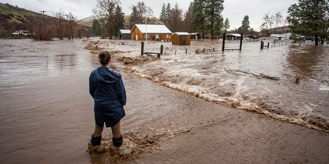 Feb. 6, 2020: Chantel Fuller watches as water floods her home in Thorn Hollow outside of Adams, Ore.