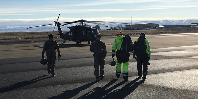 Oregon Army National Guard HH-60M-Blackhawk flight crew and members of Umatilla County Search and Rescue Volunteers get ready to begin rescue operations for community members who have become stranded due to flooding and have requested assistance.