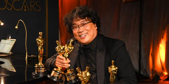 Bong Joon-ho holds the Oscars for best original screenplay, best international feature film, best directing, and best picture for 'Parasite' at the Governors Ball after the Oscars on Sunday, Feb. 9, 2020, at the Dolby Theatre in Los Angeles. (Photo by Richard Shotwell/Invision/AP)