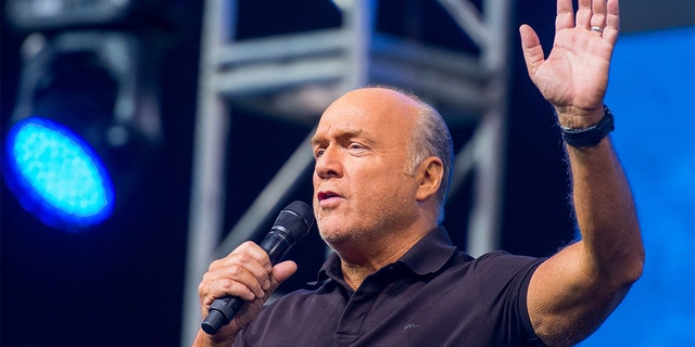 Pastor Greg Laurie speaks to thousands of faithful during the first night of the 26th Annual Harvest Crusade at Angel Stadium.(Photo by Leonard Ortiz/Digital First Media/Orange County Register via Getty Images)