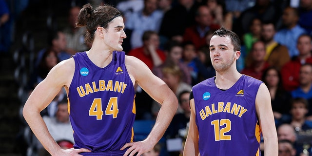 Peter Hooley, right, won a pair of conference tournament MVPs during his time at Albany. (Photo by Joe Robbins/Getty Images)