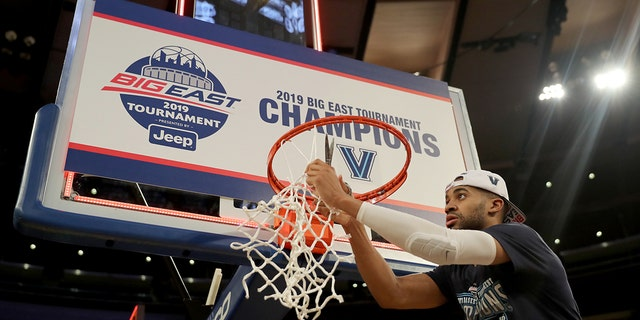 Phil Booth #5 of the Villanova Wildcats cuts down the net after the 74-72 win over the Seton Hall Pirates after the Big East Championship Game at Madison Square Garden on March 16, 2019 in New York City. (Photo by Elsa/Getty Images)