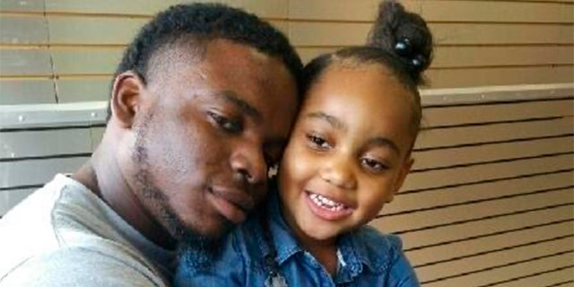 This file photo provided by the family of Michael Dean shows Dean with his daughter Te'yana. (Courtesy from Michael Dean Family via AP, File)