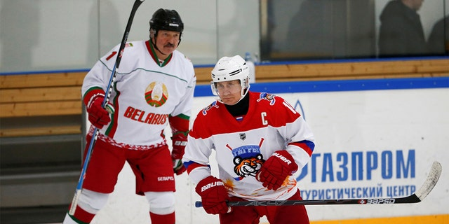 Russian President Vladimir Putin and Belarusian President Alexander Lukashenko hit the rink in Sochi. (Reuters)