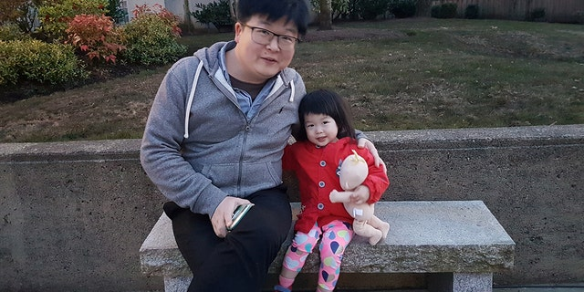 Wei Ye and his 2-year-old daughter Cerena who is stranded in China's Hubei province are seen in this undated handout photo.