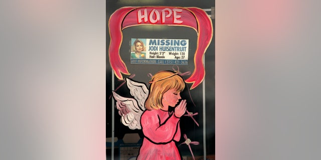 Merchants in Long Prairie decorated their store windows with angels dressed in pink. The message of the season was hope, which many thought of as hope for Jodi Huisentruit, the hometown girl who is still missing. Some merchants incorporated missing posters of Huisentruit into their holiday display. The photo was taken on 1/12/96.
